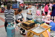 Pengzhou, China: Food Vendor in New Square Stock Images