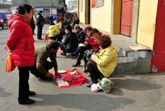 Pengzhou, China: Fortune Tellers in Long Xing Square. Fortune tellers sit on the steps of the Long Xing temple in Pengzhou, China to predict the future for the Royalty Free Stock Photos