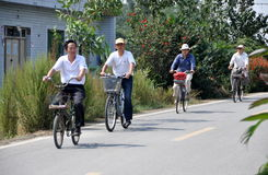 Pengzhou, China: Four Men Bicycling Royalty Free Stock Photos