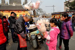 Pengzhou, China: Girl Buying Cotton Candy Royalty Free Stock Photos