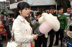 Pengzhou, China: Girl with Cotton Candy Royalty Free Stock Photography