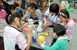 Pengzhou, China: Girls Painting Figurines Stock Images