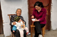 Pengzhou, China: Grandma, Mom, and Baby on Hua Lu Royalty Free Stock Image