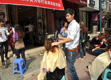 Pengzhou, China: Hair Stylist at Work Royalty Free Stock Photo