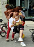 Pengzhou, China: Hair Stylists with Baby Stock Photography