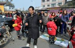 Pengzhou, China: Het spinnen T Stock Afbeelding