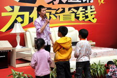 Pengzhou, China: Kids Listening to a Sales Pitch Royalty Free Stock Photos