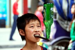 Pengzhou, China: Little Boy Balancing Bottle Royalty Free Stock Photo