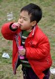 Pengzhou, China: Little Boy Blowing Bubbles Royalty Free Stock Photo