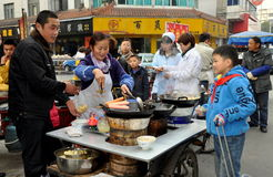 Pengzhou, China: Little Boy Buying Food Stock Photo