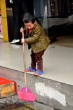 Pengzhou, China: Little Boy Mopping Sidewalk Stock Image