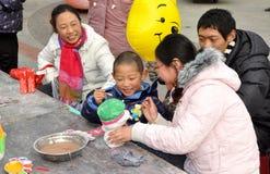 Pengzhou, China: Little Boy Painting Piggy Bank Royalty Free Stock Photos