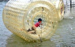 Pengzhou, China: Little Boy Playing in Water Drum Royalty Free Stock Image