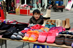 Pengzhou, China: Little Boy Selling Slippers Royalty Free Stock Image