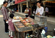 Pengzhou, China:  Little Girl Buying Hot Dog Stock Photography