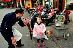 Pengzhou, China: Little Girl and Her Grandpa Stock Photo