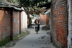 Pengzhou, China: Man on Bicycle Stock Images