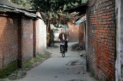 Pengzhou, China: Man on Bicycle Stock Images