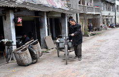 Pengzhou, China: Man with Bicycle Cart Stock Images