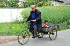 Pengzhou, China: Man and Boy on Bicycle Cart Stock Photo