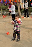 Pengzhou, China: Man and Boy Spinning Tops Royalty Free Stock Images
