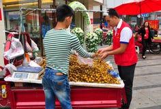 Pengzhou, China: Man Buying Longan Fruits Royalty Free Stock Photography