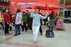 Pengzhou, China: Man Dancing with Red Cloths Royalty Free Stock Photography