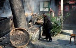 Pengzhou, China: Man at Duck Smokehouse Royalty Free Stock Photos