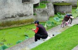 Pengzhou, China: Man Fishing in Park Stock Photos