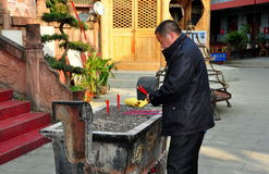Pengzhou, China: Man Lighting Incense Sticks Royalty Free Stock Images