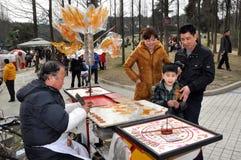 Pengzhou, China: Man Making Candy Stock Images