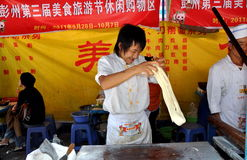 Pengzhou, China: Man Making Noodles Stock Image
