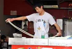 Pengzhou, China: Man Making Noodles Stock Images