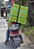 Pengzhou, China: Man on Motorcycle with Packages Stock Images