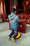 Pengzhou, China: Man Praying at Temple Royalty Free Stock Photo