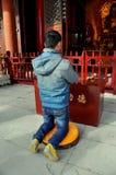 Pengzhou, China: Man Praying at Temple Royalty Free Stock Photo
