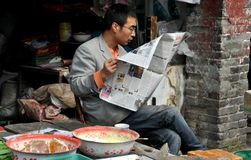 Pengzhou, China: Man Reading Newspaper Royalty Free Stock Photography