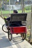 Pengzhou, China: Man Resting in Bicycle Cart Stock Images