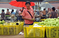 Pengzhou, China: Man Selling Apples Royalty Free Stock Photography