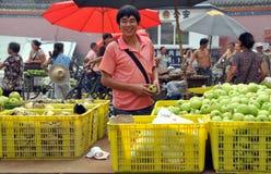 Pengzhou, China: Man Selling Apples Royalty Free Stock Photography
