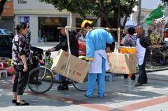 Pengzhou, China: Man Selling Cakes Stock Photos