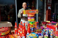 Pengzhou, China: Man Selling Holiday Fireworks Stock Photo