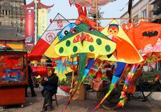 Pengzhou, China: Man Selling Kites Stock Photo