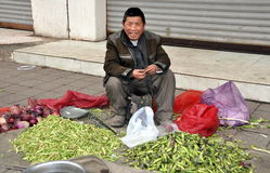 Pengzhou, China: Man Selling Lima Beans Royalty Free Stock Photography