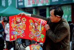 Pengzhou, China: Man Selling New Year decorations Royalty Free Stock Images