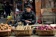 Pengzhou, China: Man Selling Produce at Market Royalty Free Stock Image