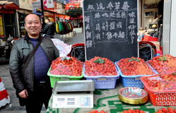 Pengzhou, China: Man Selling Strawberries Royalty Free Stock Photography