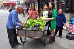 Pengzhou, China: Man Selling Vegetables Royalty Free Stock Photos