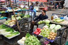 Pengzhou, China: Man Selling Vegetables Stock Image