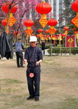 Pengzhou, China: Man Spinning Top Stock Images